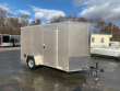 COVERED WAGON 6' X 10' BEIGE ENCLOSED CARGO TRAILER W/RAMP
