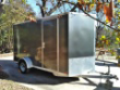 NEARLY NEW ALL ALUMINUM CARGOMATE 6X12 TRAILER