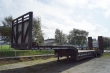 JPM 3 AXLE JUMBO MACHINE TRAILER WITH HYDR RAMPS AND M