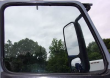 VOLVO VNM LEFT DOOR WINDOW