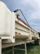 1995 TRAVIS 35FT END DUMP TRAILER- QUARTER FRAME, STEEL BOX, TANDEM AXLE, ELECTRIC TARP SYSTEM, ALL WHEELS STAY ON THE GROUND WHEN DUMPING
